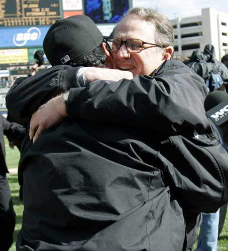 Chicago White Sox owner Jerry Reinsdorf, right, hugs manager Ozzie Guillen after they clinched the American League Central Division title Thursday, Sept. 29, 2005, in Detroit. The White Sox beat the Tigers, 4-2.  <span class=meta>(AP Photo&#47;Duane Burleson)</span>